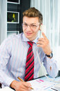 Successfull young business man speaking on the phone Stock Image