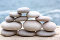 Successfully teamwork metaphor pebble pyramid over the sea Royalty Free Stock Photo