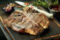 Succulent thick tender barbecued t-bone steak Royalty Free Stock Photo