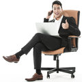 The sucessful businessman multitasking between his laptop and phone Stock Image