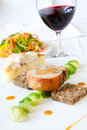 Suckling Pig Steak served with Wine Royalty Free Stock Photo
