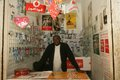A Sudanese refugee in his mobile phone shop Stock Photos