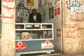 A Sudanese refugee in his mobile phone shop Royalty Free Stock Images