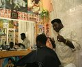 A Sudanese refugee working in a barber shop Royalty Free Stock Images