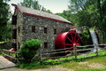 Sudbury ma old stone grist mill the with water wheel and cascade still grinds flour for nearby longfellow s wayside inn in Stock Photo