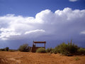 Sudden storm clouds roll in for a rare summer downpour in desert Royalty Free Stock Image