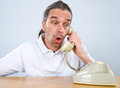 Sudden telephone call amazed man is calling with old Royalty Free Stock Image