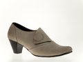 Suede women shoe beige high heeled Stock Photo