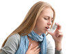 Suffering from asthma young woman using an inhaler as prevention Royalty Free Stock Photo