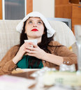 Suffering brunnette woman at home on sofa Stock Photo