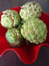Sugar apple custard apple red bowl wood Royalty Free Stock Photography