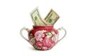 Sugar basin with dollar bills isolated Stock Photography