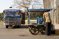 Sugar cane juice seller and bus goa india Stock Photos