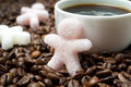 Sugar in the form of a little man and a cup of coffee close up horizontal Stock Images