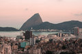 Sugar loaf view a of with a favela in foreground from santa teresa hill rio de janeiro brazil Royalty Free Stock Photography