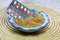 Sugar the pill tablets in sugar or pills a bowl of brown a sweetener Stock Images