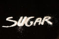 Sugar sign on a black background Royalty Free Stock Photography