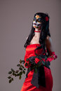 Sugar skull girl in red evening dress halloween shot Royalty Free Stock Photography