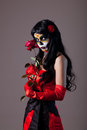Sugar skull girl with red rose Royalty Free Stock Photo