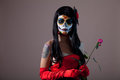 Sugar skull girl with red rose halloween shot Royalty Free Stock Photos