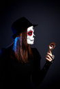 Sugar skull make up girl with looking at the mirror on the day of the dead at black background Royalty Free Stock Photos