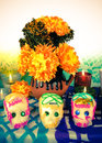 Sugar skulls on day of the dead dia de muertos traditional mexican altar with flowers and candles Royalty Free Stock Photo