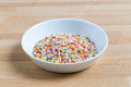 Sugar sprinkles in a bowl on wood Stock Photography