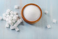 Sugar on wooden table selective focus Royalty Free Stock Images