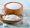 Sugar on wooden table selective focus Stock Photos