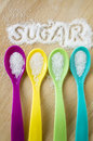 Sugar words with color spoon on wooden colorful Stock Images
