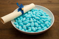 Sugared almonds blue on wooden table Stock Image