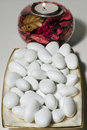 Sugared almonds with candle Royalty Free Stock Photos