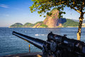 Sugarloaf mountain cannon at the waterfront with in the background guanabara bay rio de janeiro brazil Stock Photography
