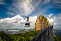 Sugarloaf mountain overhead cable car approaching guanabara bay rio de janeiro brazil Royalty Free Stock Images