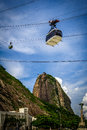 Sugarloaf mountain overhead cable in motion with in the background guanabara bay rio de janeiro brazil Stock Images