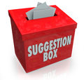Suggestion box ideas submission comments a red sugestion with notes of paper stuffed into its slot offering feedback and Royalty Free Stock Image