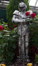 Suit of armor amongst dahlias at the muttart conservatory edmonton Stock Photo
