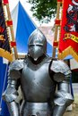 Suit of armor a medieval with flags in the background Stock Photography