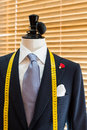 Suit on mannequin in tailors shop Stock Image