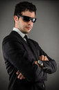Suit and sunglasses image of a young business man wearing Stock Photo