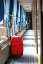 Suitcase in corridor of  railway wagon Stock Photo