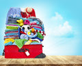 Suitcase Full Of Clothes, Open Luggage with Travel Baggage Royalty Free Stock Photo