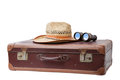 Suitcase with hat and binoculars old used antique isolated on white background Royalty Free Stock Photography
