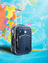 Suitcase on the map journey standing Stock Photography