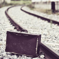Suitcase next to the railroad tracks Royalty Free Stock Photo