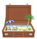 Suitcase open with sea and beach scene in side