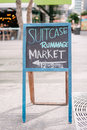 Suitcase rummage market brisbane australia blackboard message city sale set up at the top of the mall april Royalty Free Stock Images