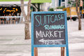 Suitcase rummage market brisbane australia blackboard message city sale set up at the top of the mall april Royalty Free Stock Photo