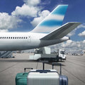 Suitcases front airplane Royalty Free Stock Photo