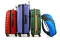Suitcases and rucksack on white luggage consisting of large Royalty Free Stock Photo